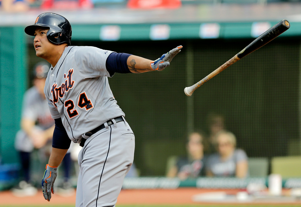 . Detroit Tigers\' Miguel Cabrera watches his ball after hitting a two-run home run off Cleveland Indians starting pitcher Corey Kluber in the first inning of a baseball game, Monday, Sept. 1, 2014, in Cleveland. Ian Kinsler scored on the play. (AP Photo/Tony Dejak)