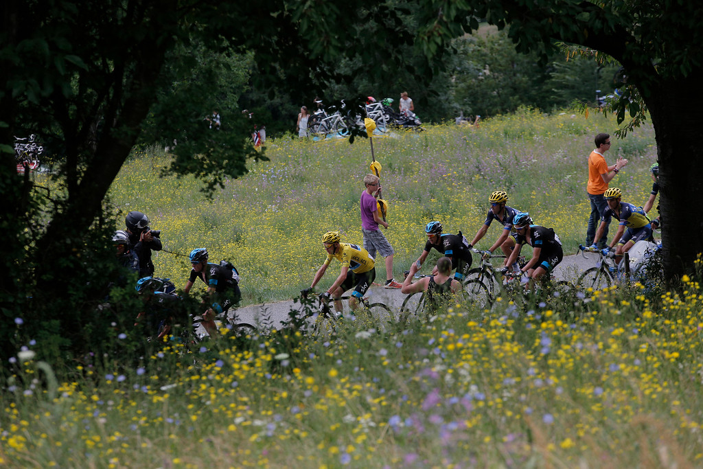 . Christopher Froome of Britain, wearing the overall leader\'s yellow jersey, rides in the pack during the nineteenth stage of the Tour de France cycling race over 204.5 kilometers (127.8 miles) with start in in Bourg-d\'Oisans and finish in Le Grand-Bornand, France, Friday July 19 2013. (AP Photo/Christophe Ena)