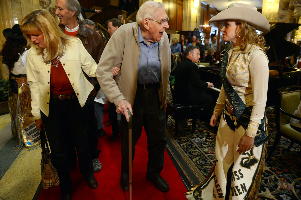 . DENVER, CO. - JANUARY 25: Kenneth Schutt, center, and his niece Elaine Strasser talk with Miss Evergreen Rodeo, Kelly Arbogast, right, while waiting to see the National Western Stock Show\'s Grand Champion and Reserve Steers at the Brown Palace Hotel & Spa in Denver, CO, January, 25, 2013. The Grand Champion ,Trevor, weighing in at 1335 lbs. was raised by Shilo Schaake of Westmoreland, KS. The Reserve Grand Champion, Nick, 1275 lbs, was shown by  Jessica Webster of Runnells, IA. The skittish champions were also joined by a third steer, Willie, raised by Lauren May, of Mineral Point, WI, for moral support. (Photo By Craig F. Walker / The Denver Post)