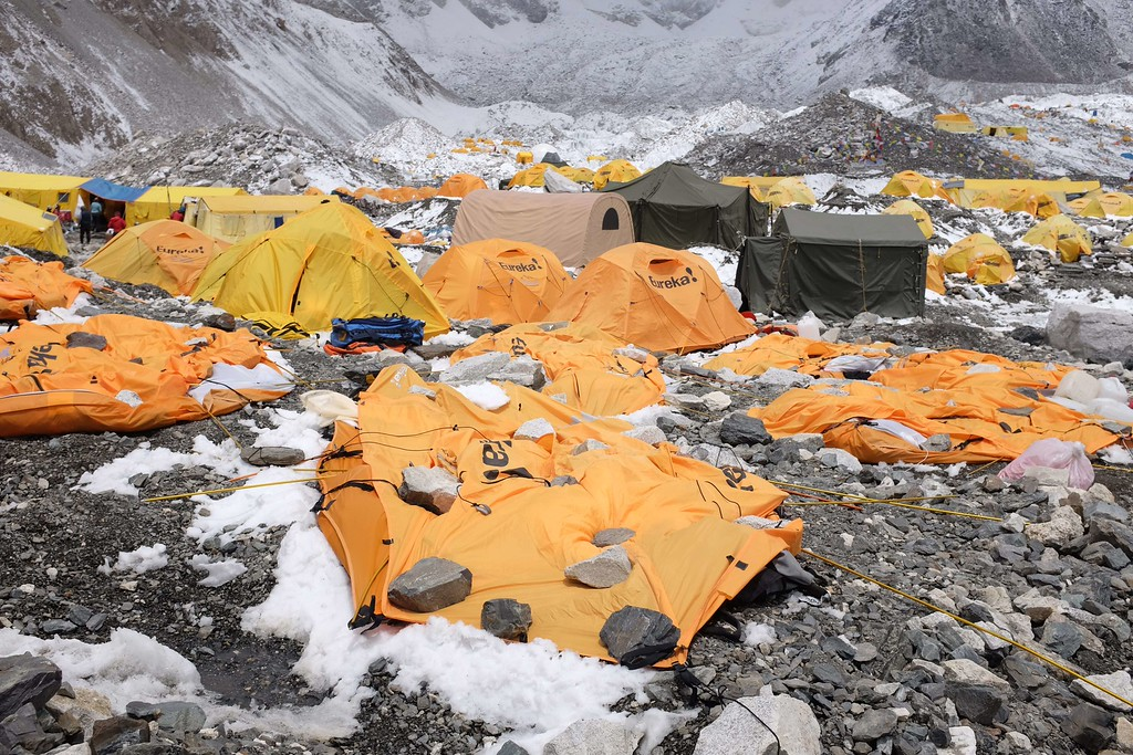 . In this photograph taken on April 26, 2015, rocks are kept over flattened tents at Everest Base Camp, to cover the bodies of some of the people that died a day earlier as an earthquake triggered avalanche crashed through parts of the base camp killing scores of people.  Rescuers faced a race against time on April 29, to find survivors of a mammoth earthquake that killed more than 5,000 people when it through Nepal five days ago and devastated large parts of one of Asia\'s poorest nations.   AFP PHOTO/ROBERTO SCHMIDT/AFP/Getty Images