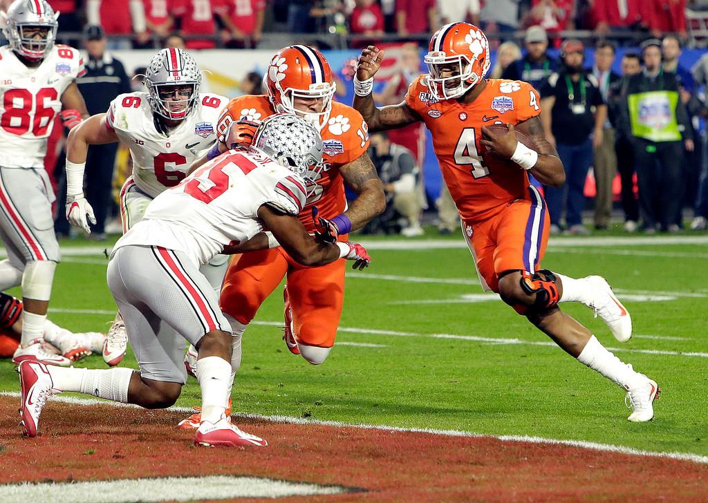 . Clemson quarterback Deshaun Watson (4) runs for a touchdown against Ohio State during the first half of the Fiesta Bowl NCAA college football playoff semifinal, Saturday, Dec. 31, 2016, in Glendale, Ariz. (AP Photo/Rick Scuteri)