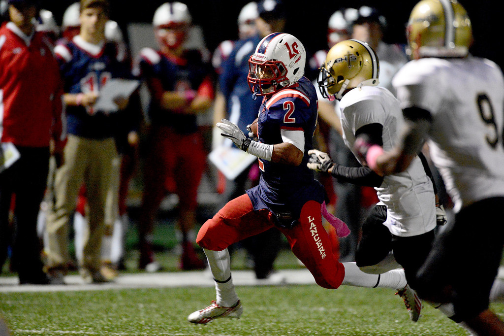 . La Salle\'s Bryce Harvey (2) gains yards as they play Bishop Montgomery during the second quarter in Friday night\'s football game at La Salle High School in Pasadena, October 25, 2013.  (Photo by Sarah Reingewirtz/Pasadena Star-News)