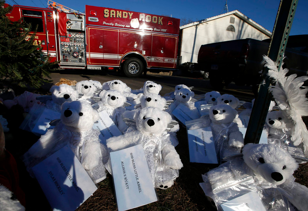 Description of . White teddy bears bearing the names of all those killed in the December 14 shootings at the Sandy Hook Elementary School sit in a makeshift memorial outside the Sandy Hook Fire Department in Sandy Hook village in Newtown, Connecticut, December 19, 2012. Six funerals for victims of the shootings were being held Wednesday in the Newtown area. REUTERS/Mike Segar