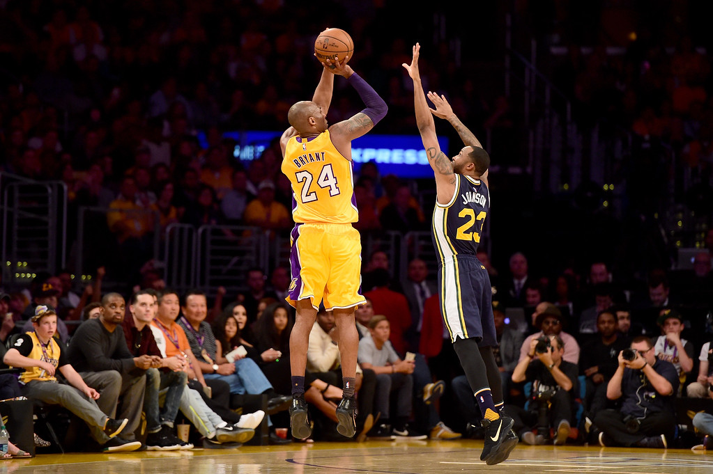 . LOS ANGELES, CA - APRIL 13:  Kobe Bryant #24 of the Los Angeles Lakers shoots over Chris Johnson #23 of the Utah Jazz in the first half at Staples Center on April 13, 2016 in Los Angeles, California. NOTE TO USER: User expressly acknowledges and agrees that, by downloading and or using this photograph, User is consenting to the terms and conditions of the Getty Images License Agreement.  (Photo by Harry How/Getty Images)