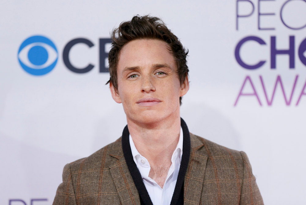 ". Actor Eddie Redmayne, of the film ""Les Miserables,\"" arrives at the 2013 People\'s Choice Awards in Los Angeles, January 9, 2013.   REUTERS/Danny Moloshok"