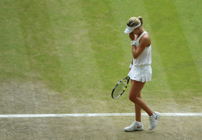 . Eugenie Bouchard of Canada puts her hand to her face as she reacts to losing a point against Petra Kvitova of Czech Republic during the women\'s singles final at the All England Lawn Tennis  Championships at Wimbledon, London, Saturday, July, 5, 2014. (AP Photo/Gareth Fuller, Pool)