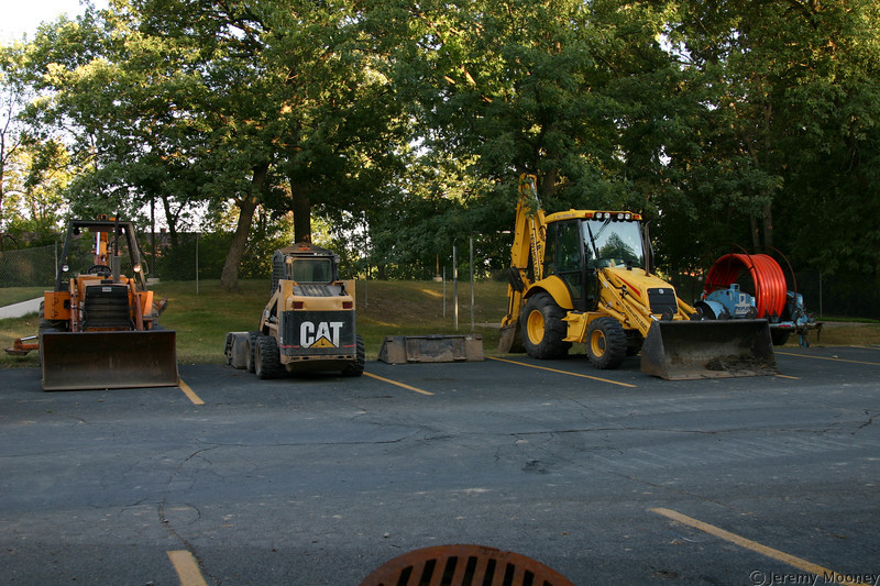 Equipment parking lot.  How fun it would be to go inside the fence...