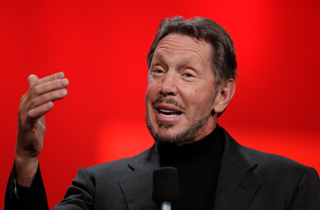 . Oracle CEO Larry Ellison gestures while giving a keynote address at Oracle OpenWorld in San Francisco, Tuesday, Oct. 2, 2012. Ellison says he plans to turn the Hawaiian island that he recently bought into a laboratory for experimenting with more environmentally sound ways of living. Ellison says he hopes to convert sea water into fresh water on the 141-mile-square mile island of Lanai. He also wants more electric cars on the island and hopes to increase its fruit exports to Japan and other markets. (AP Photo/Eric Risberg)