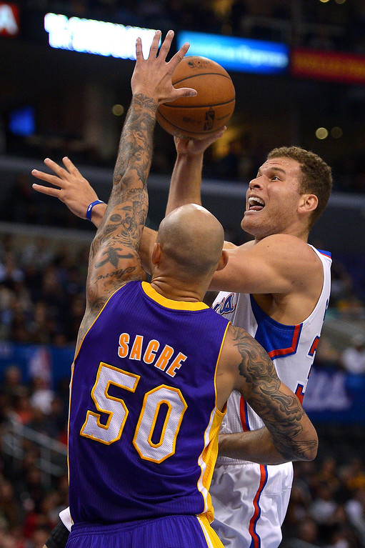 . The Clippers\' Blake Griffin drives to the basket against the Lakers Robert Sacre. (Photo by Michael Owen Baker/L.A. Daily News)