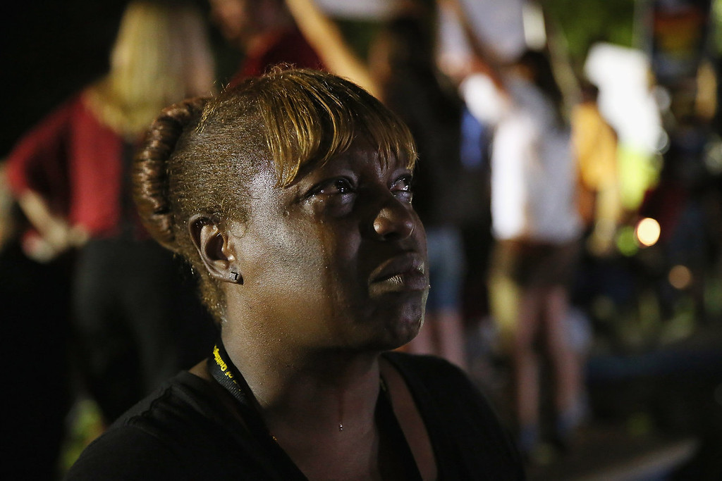 . Tanetta Foster breaks into tears in front of the Seminole County Criminal Justice Center after learning George Zimmerman had been found not guilty in the Murder of Trayvon Martin on July 13, 2013 in Sanford, Florida. Zimmerman, a neighborhood watch volunteer shot and killed 17-year-old Martin after an altercation in February 2012.  (Photo by Scott Olson/Getty Images)