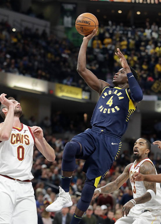 . Indiana Pacers\' Victor Oladipo (4) shoots in front of Cleveland Cavaliers\' Kevin Love during the second half of an NBA basketball game Friday, Dec. 8, 2017, in Indianapolis. The Pacers won 106-102. (AP Photo/Darron Cummings)