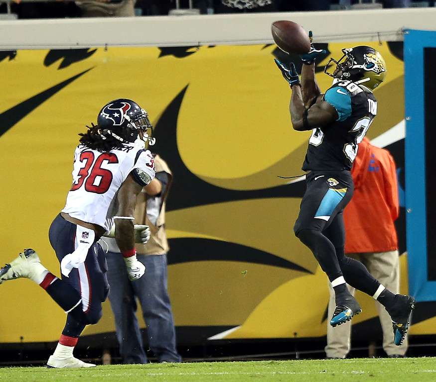 . Jags RB Jordan Todman (30) gathers in a pass from Ace Sanders for a TD at 6:12 in the 3rd quarter for the Jaguars to take a 24-10 lead. The Jacksonville Jaguars played a Thursday night game on Dec. 5, 2013 against the Houston Texans on EverBank Field in Jacksonville, FL.   (AP Photo/The Florida Times-Union,Gary McCullough)