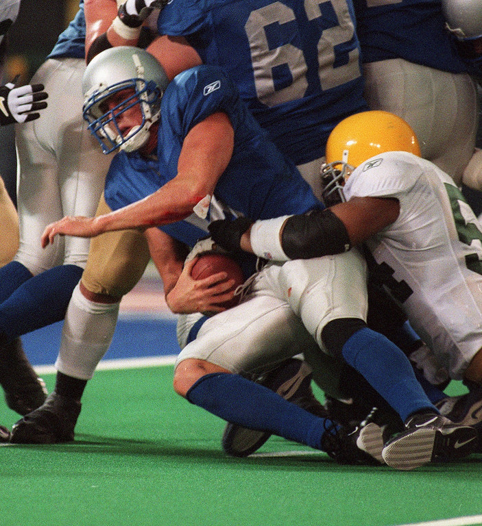 . Detroit Lions quarterback Mike McMahon (left) is tackled by Green Bay Packer linebacker Nate Wayne (right) on a quarterback keeper late in the fourth quarter of the Lions\' 29-27 loss Thanksgiving Day at the Pontiac Silverdome.