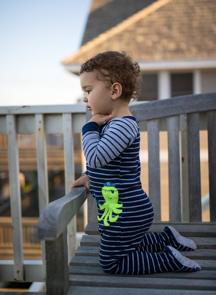 Caleb checking out the  beach from the balcony.jpg