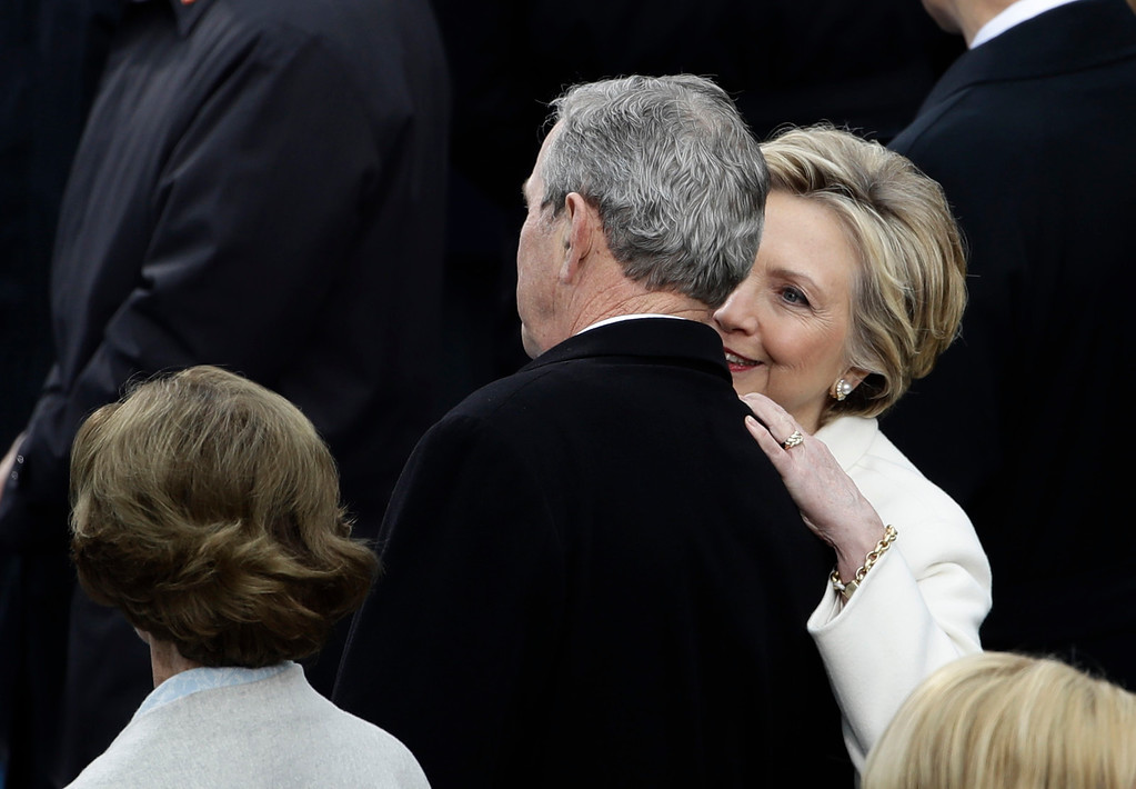 . Former Secretary of State Hillary Clinton speaks to Former President George W. Bush and his wife Laura before the 58th Presidential Inauguration for President-elect Donald Trump at the U.S. Capitol in Washington, Friday, Jan. 20, 2017. (AP Photo/Matt Rourke)