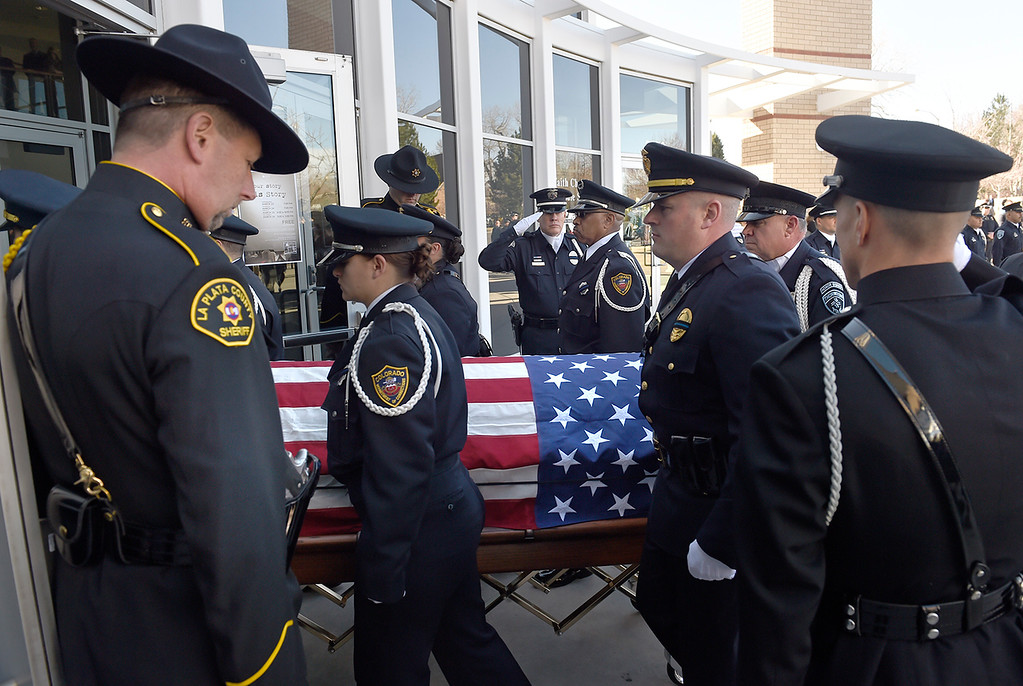 . Law enforcement officers carry Park County Corporal Nate Carrigan into Faith Bible Chapel in Arvada. (Photo by Helen Richardson/The Denver Post)