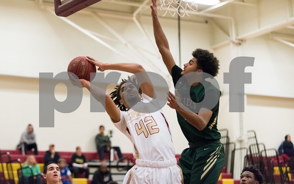 01/23/18 Wesley Bunnell | Staff New Britain boys basketball vs Enfield on Tuesday evening at New Britain High School. Jahfari Newman (42).