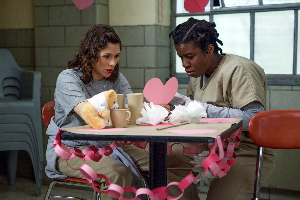 . This image released by Netflix shows Yael Stone, left, and Uzo Aduba in a scene from �Orange is the New Black.�  Aduba was nominated for a Golden Globe for best supporting actress in a TV movie or mini-series for her role on Thursday, Dec. 11, 2014. The 72nd annual Golden Globe awards will air on NBC on Sunday, Jan. 11. (AP Photo/Netflix, K.C. Bailey)