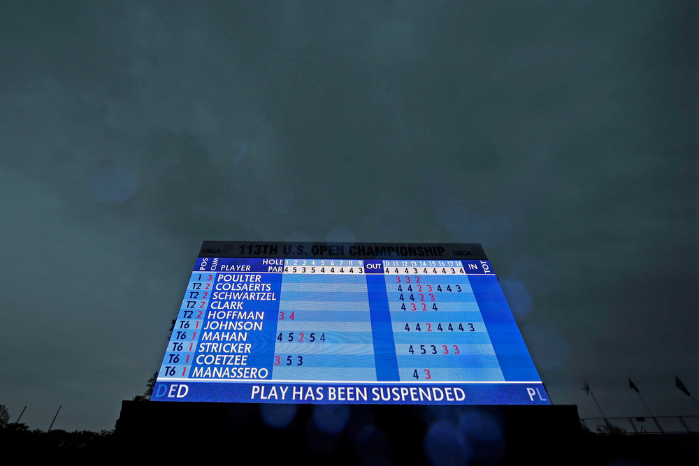 . A video leader board is shown as a weather warning delays the first round of the U.S. Open golf tournament at Merion Golf Club, Thursday, June 13, 2013, in Ardmore, Pa. (AP Photo/Darron Cummings)