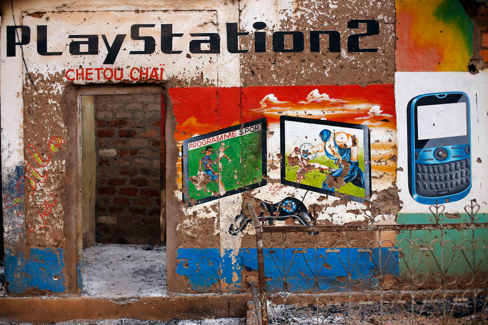 . A Muslim owned computer shop stands looted in the Miskin district of Bangui, Central African Republic, Tuesday Feb. 4, 2014. (AP Photo/Jerome Delay)