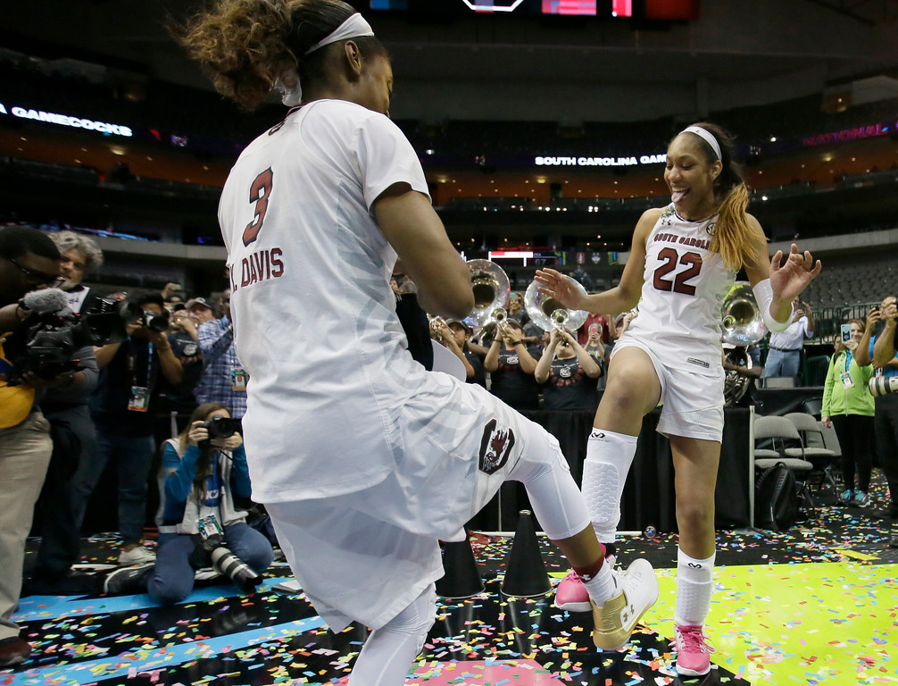 . South Carolina forward A\'ja Wilson (22) and South Carolina guard Kaela Davis (3) dance as the South Carolina band plays as they celebrate their win over Mississippi State in the final of NCAA women\'s Final Four college basketball tournament, Sunday, April 2, 2017, in Dallas. South Carolina won 67-55. (AP Photo/LM Otero)