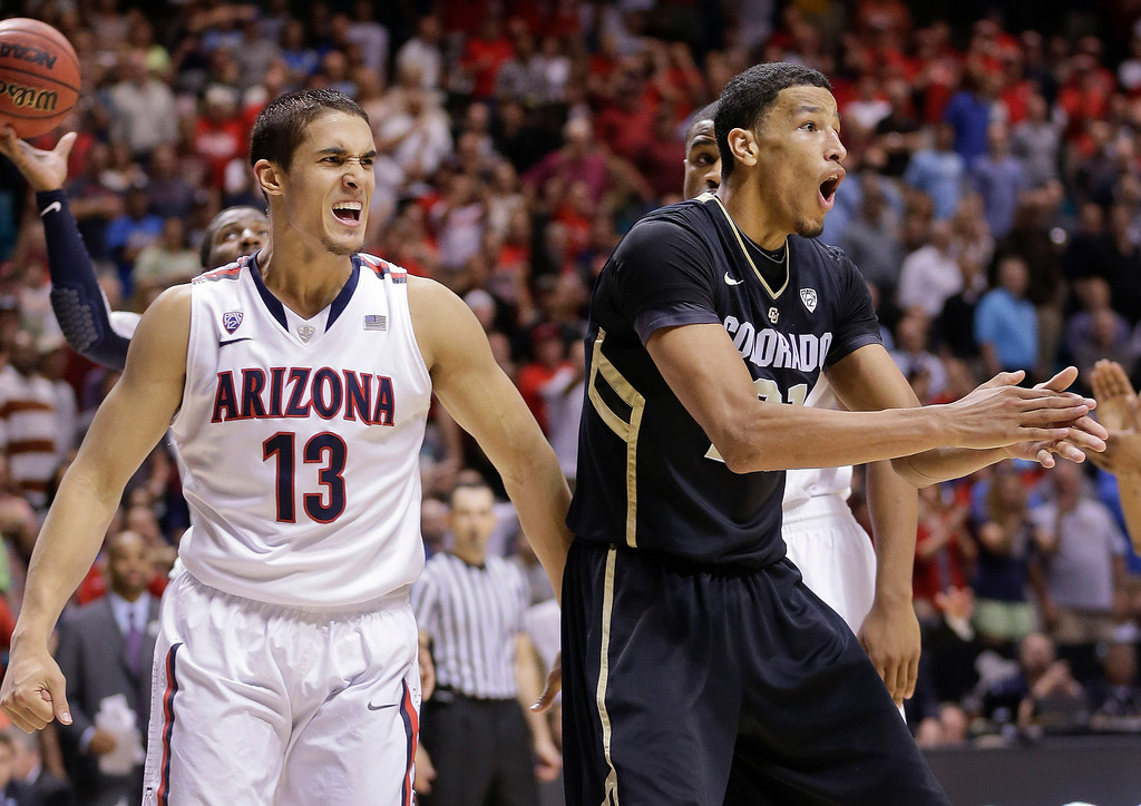 . Arizona\'s Nick Johnson (13) and Colorado\'s Andre Roberson (21) react after Roberson was called for an offensive foul late in the second half during a Pac-12 men\'s tournament NCAA college basketball game, Thursday, March 14, 2013, in Las Vegas. (AP Photo/Julie Jacobson)