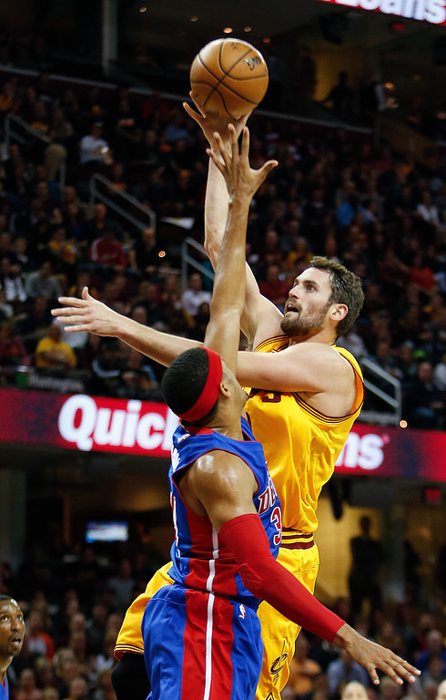 . Cleveland Cavaliers\' Kevin Love shoots over Detroit Pistons\' Tobias Harris during the first half of an NBA basketball game Friday, Nov. 18, 2016, in Cleveland. (AP Photo/Ron Schwane)