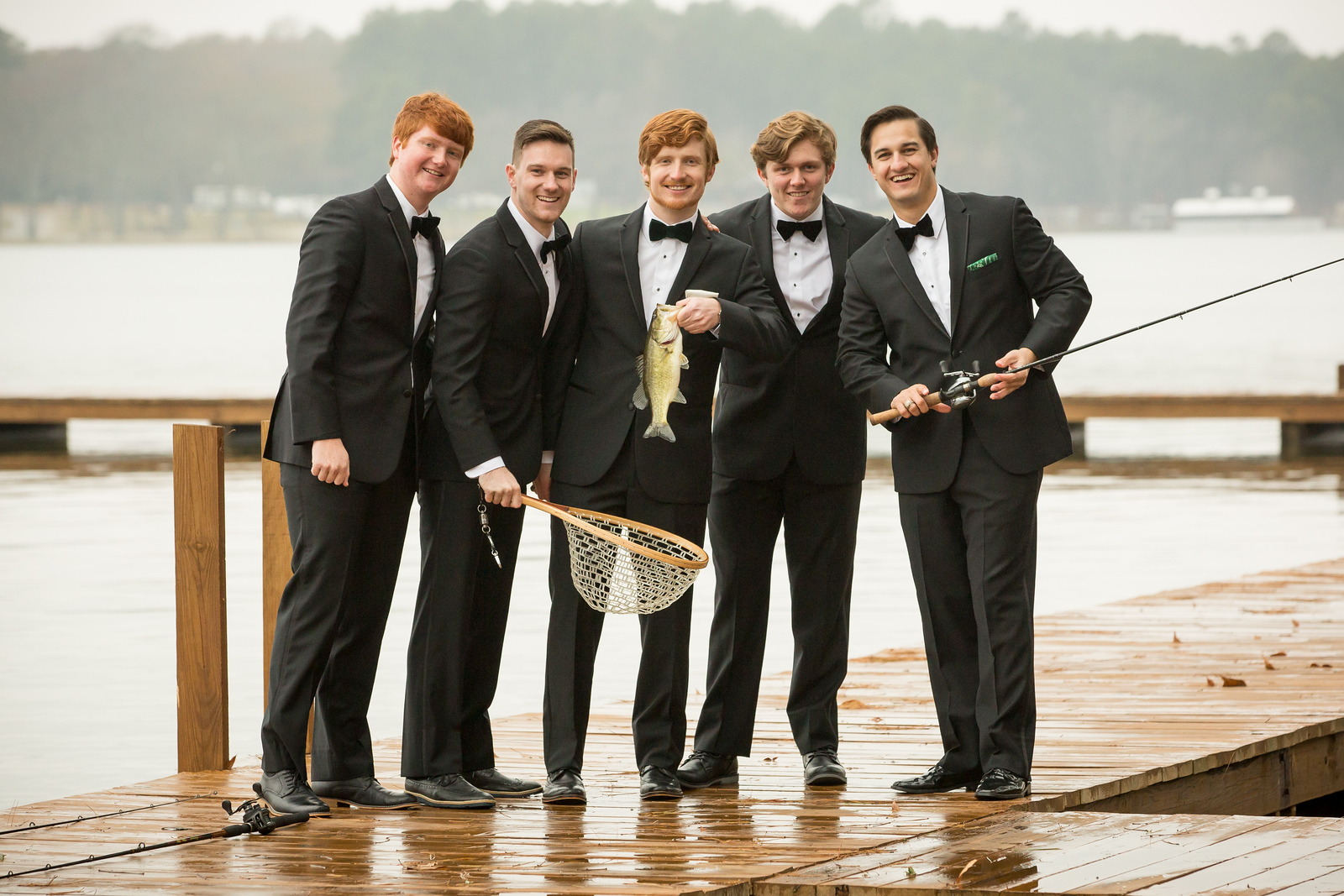 A groom and his groomsmen fishing on the wedding day