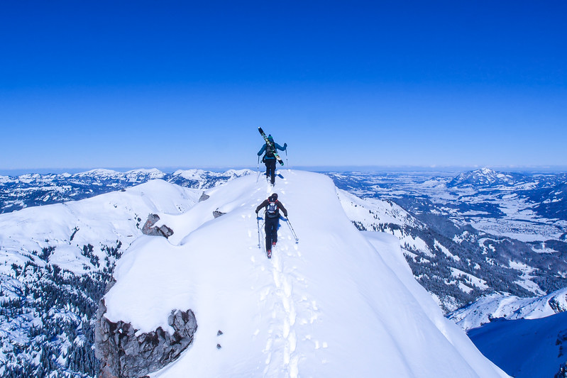 Two tourers aiming to ski down directly from the summit.