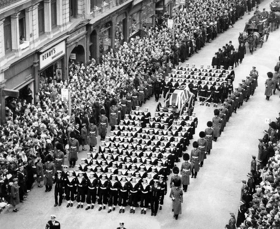 . In a file picture taken on January 30,1965 marines lead the funeral march escorting Britain\'s former prime minister Winston Churchill\'s coffin as the crowd pays respects on Ludgate Hill in London. Fifty years after Winston Churchill\'s death, Britain paid tribute on January 30, 2015 to its wartime prime minister, who remains a touchstone of political life and a reminder of a faded age of global influence. AFP PHOTO / STR-/AFP/Getty Images