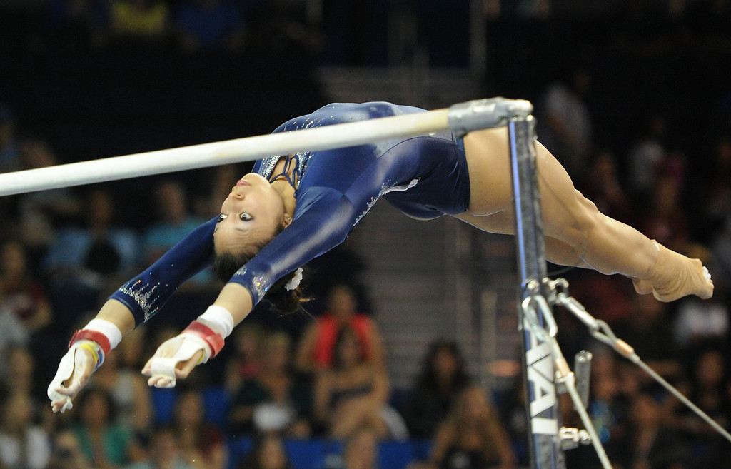 . UCLA\'s Vanessa Zamarripa performs on the uneven parallel bars at the NCAA Women\'s Gymnastics Championship Team Finals at Pauley Pavilion, Saturday, April 20, 2013. (Michael Owen Baker/Staff Photographer)