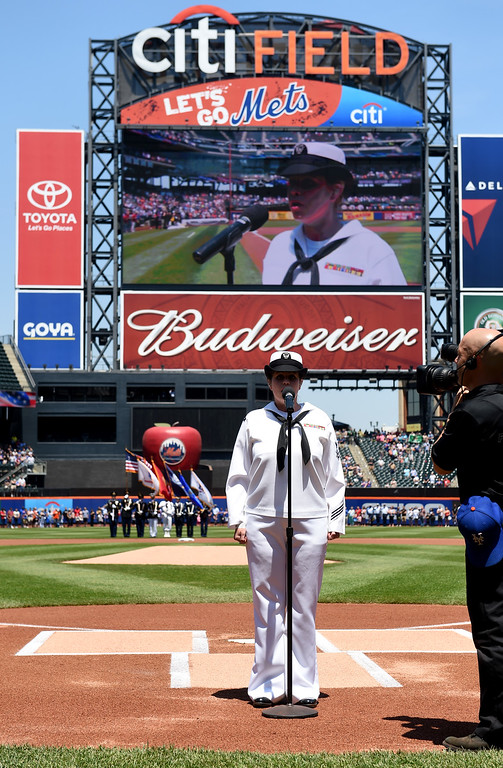 . Laura Carey of the US Navy sings the National Anthem before the baseball game against the Philadelphia Phillies as part of Memorial Day ceremonies at Citi Field on Monday, May 25, 2015, in New York. (AP Photo/Kathy Kmonicek)