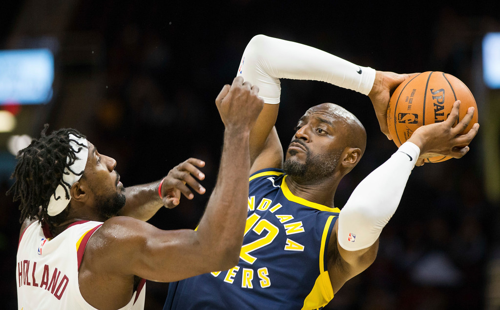 . Indiana Pacers\' Damien Wilkins (12) keeps the ball away from Cleveland Cavaliers\' John Holland during the fourth quarter of an NBA preseason basketball game, Friday, Oct. 6, 2017, in Cleveland. The Pacers won 106-102. (AP Photo/Scott R. Galvin)
