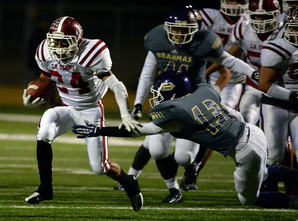 . La Serna\'s Anthony Garcia (24) runs past Diamond Bar\'s Chris Torres (13) for a first down in the first half of a CIF-SS playoff football game at Diamond Bar High School in Diamond Bar, Calif., on Friday, Nov. 22, 2013.   (Keith Birmingham Pasadena Star-News)