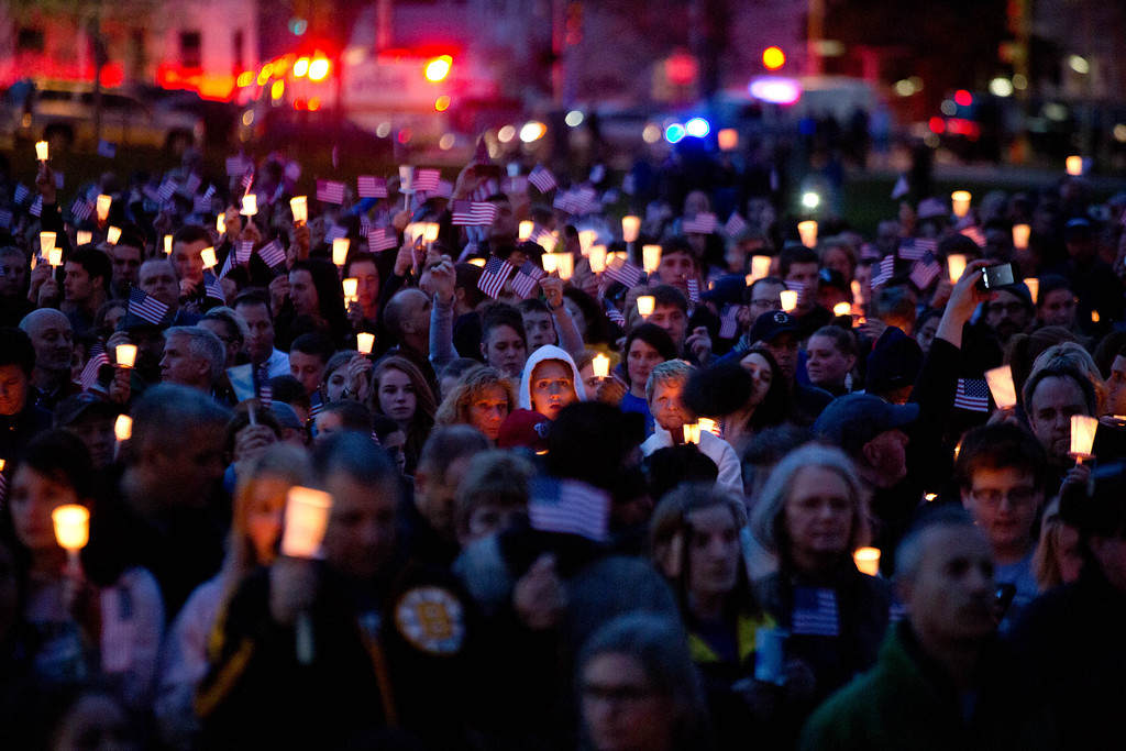 . Mourners attend candlelight vigil for Martin Richard at Garvey Park, near Richard\'s home in the Dorchester section of Boston, on Tuesday, April 16, 2013. Martin is the 8-year-old boy killed in the Boston Marathon bombing. (AP Photo/The New York Times, Josh Haner)