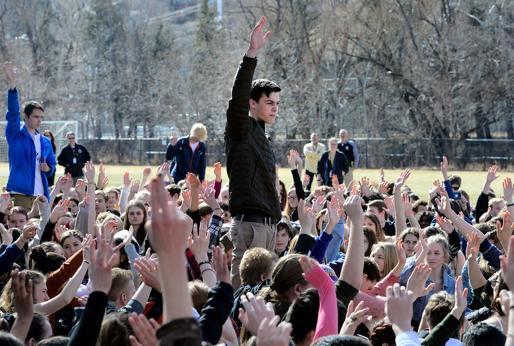 . Alec Eyl asks for a show of hands from those who believe in gun control during a walkout to protest gun violence at Boulder High School on Wednesday morning.  For more photos go to dailycamera.com Paul Aiken Staff Photographer March 14, 2018.