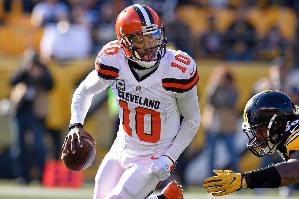 . Cleveland Browns quarterback Robert Griffin III (10) rolls out under pressure by Pittsburgh Steelers defensive tackle L.T. Walton (96) during the first half of an NFL football game in Pittsburgh, Sunday, Jan. 1, 2017. (AP Photo/Don Wright)