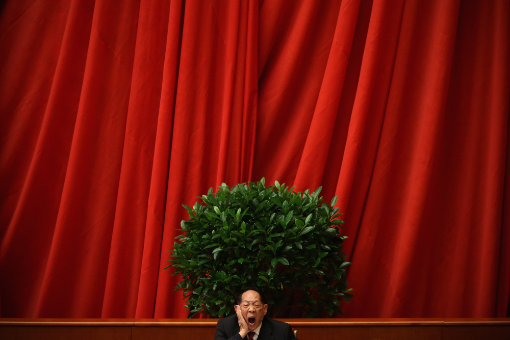 Description of . A scientist delegate yawns at stage during the closing session of the 18th National Congress of the Communist Party of China (CPC) inside the Great Hall of the People on November 14, 2012 in Beijing, China. Members of the Standing Committee of the Political Bureau of the new CPC Central Committee will meet with journalists on November 15, 2012.  (Photo by Feng Li/Getty Images)