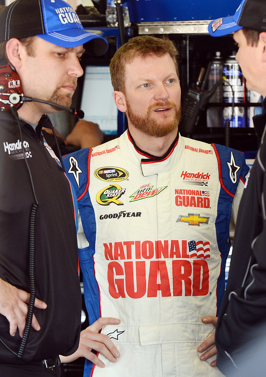 . (Will Lester/Staff Photographer) NASCAR driver Dale Earnhardt Jr. waits in the garage for his car to be prepared during the opening practice session for Sunday\'s Auto Club 400 Friday March 22, 2013.