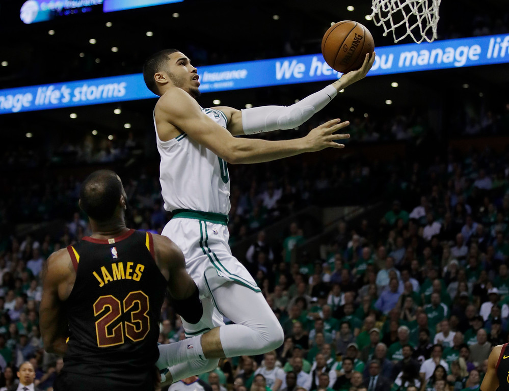 . Boston Celtics forward Jayson Tatum (0) goes to the basket over Cleveland Cavaliers forward LeBron James (23) during the fourth quarter of Game 5 of the NBA basketball Eastern Conference finals Wednesday, May 23, 2018, in Boston. (AP Photo/Charles Krupa)