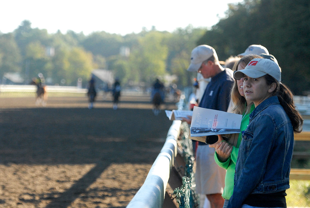 . People line up on the backstretch to view early morning workouts on the Saratoga Race Course, hours before opening hours for the Travers Day on Saturday morning.Photo Erica Miller/The Saratogian 8/24/13 news_TheMadDash10