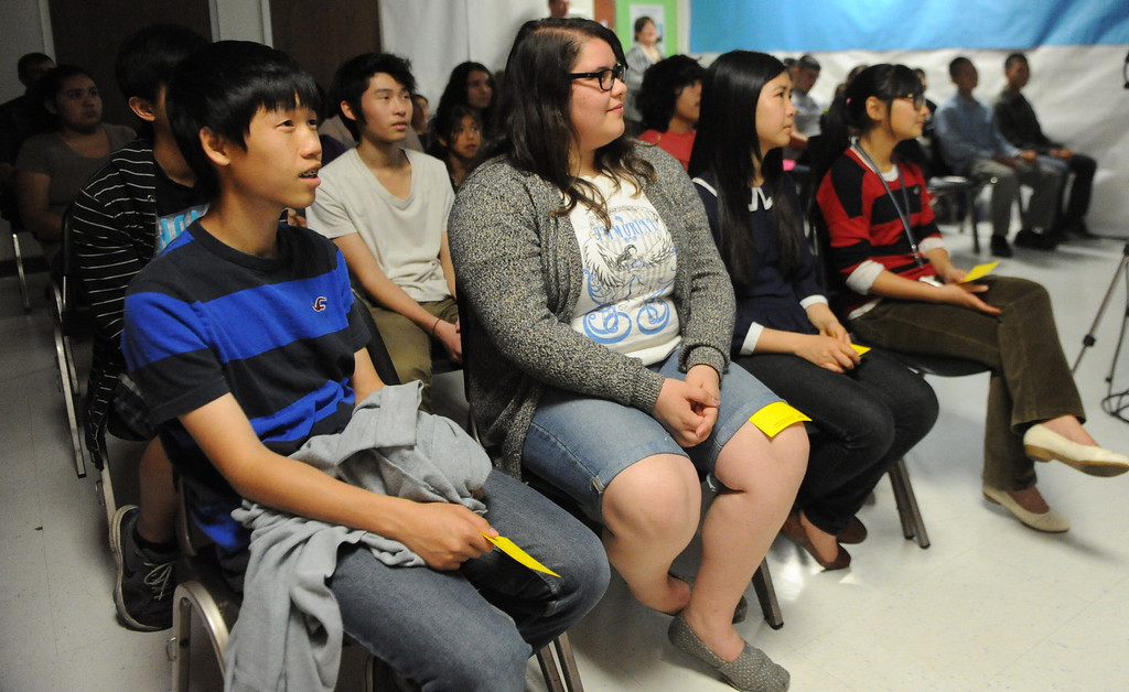. Teens listen to Ron Streicher of the Los Angeles Opera Community Educational program during a Los Angeles Opera slide show presentation on the opera �Cinderella,� composed by Gioachino Rossini at Norwood Library on Saturday, March 30, 2013 in El Monte, Calif.  (Keith Birmingham Pasadena Star-News)