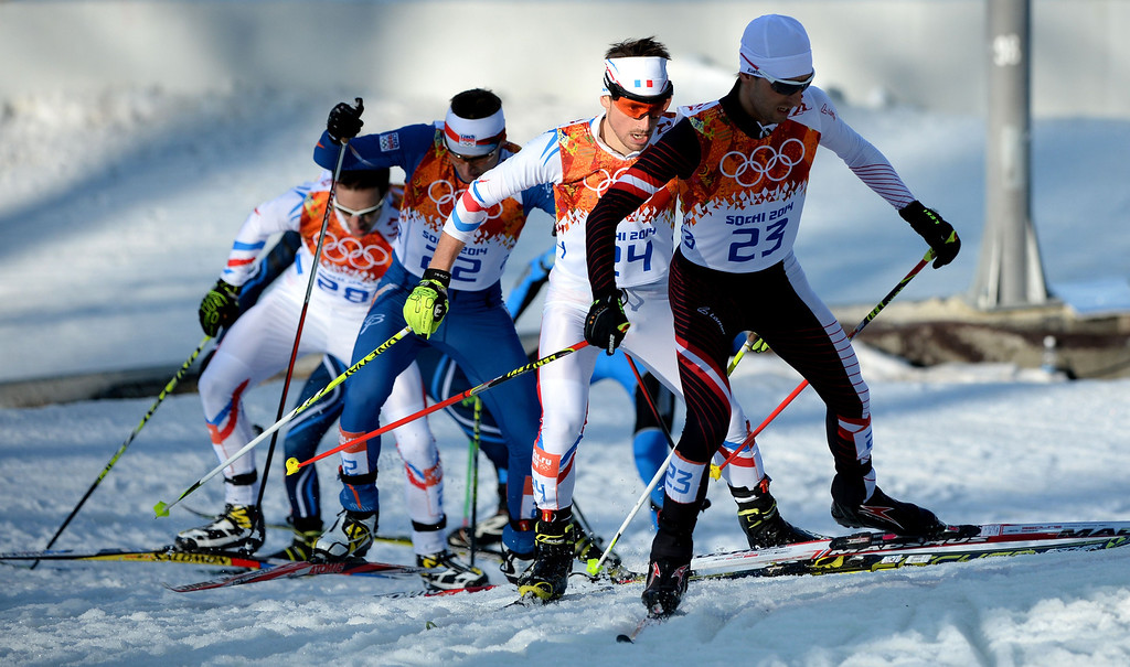 . From left to right:- France\'s Sebastien Lacroix, Czech Republic\'s Pavel Churavy, France\'s Francois Braud and Austria\'s Mario Stecher compete in of the Nordic Combined Individual NH / 10 km Cross-Country at the RusSki Gorki Jumping Center during the Sochi Winter Olympics on February 12, 2014 in Rosa Khutor near Sochi.   AFP PHOTO / PETER PARKS/AFP/Getty Images