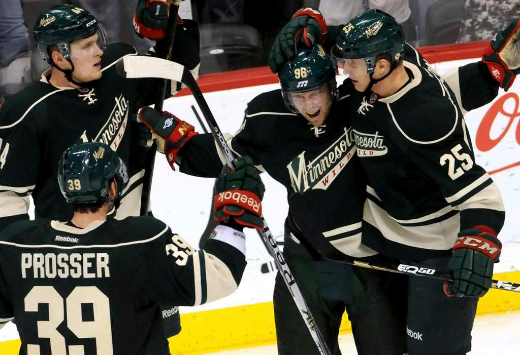 . Minnesota Wild players celebrate a goal during a game at the Xcel Energy Center in St. Paul. (Pioneer Press: Sherri LaRose-Chiglo)