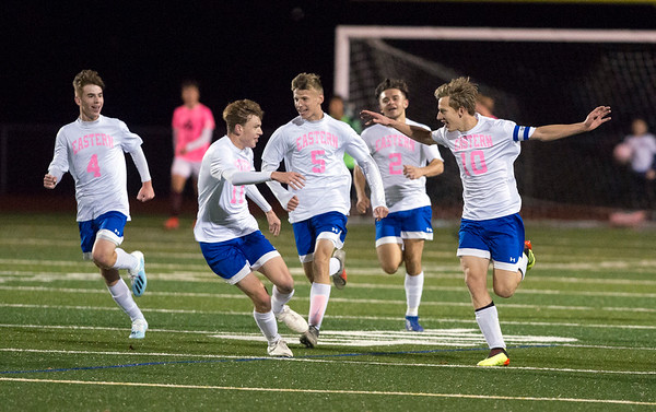 11/04/19 Wesley Bunnell | StaffrrBristol Eastern vs Bristol Central boys soccer on Monday night at Bristol Eastern High School. Bristol Eastern's Jacob Woznicki (10) celebrates his first half goal as he's greeted by teammates midfield.