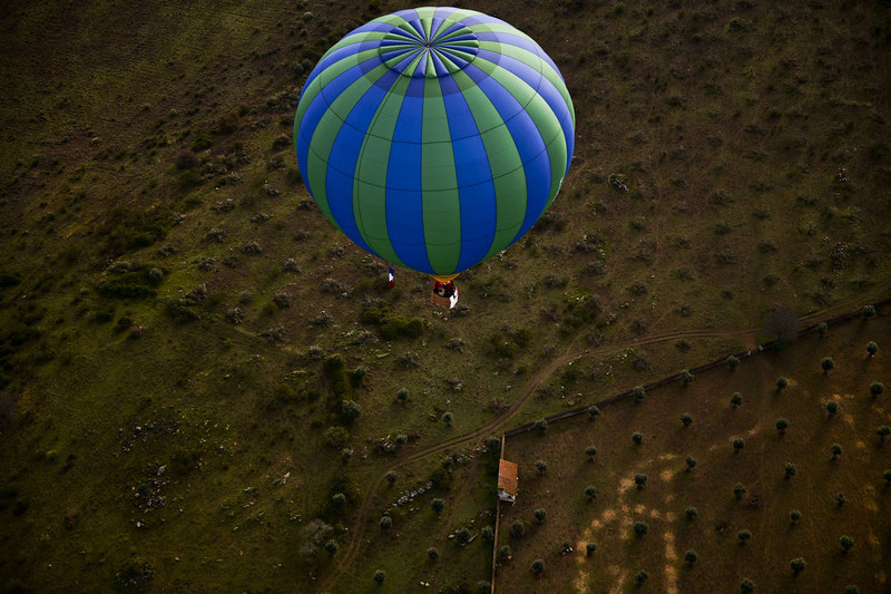. A balloon flies over countryside during the 18th International Festival of Hot Air Balloons in Alter do Chao in the center of Portugal on November 10 2014. PATRICIA DE MELO MOREIRA/AFP/Getty Images