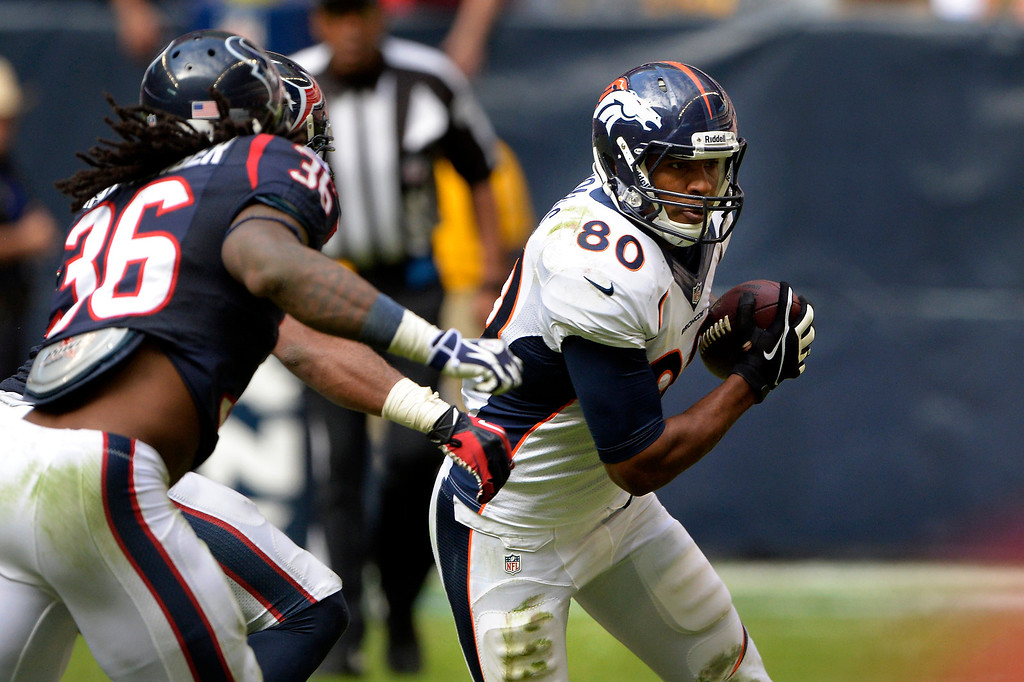 . Tight end Julius Thomas #80 of the Denver Broncos makes a catch in the second half against the Houston Texans at Reliant Stadium December 22, 2013 Houston, Texas. (Photo By Joe Amon/The Denver Post)