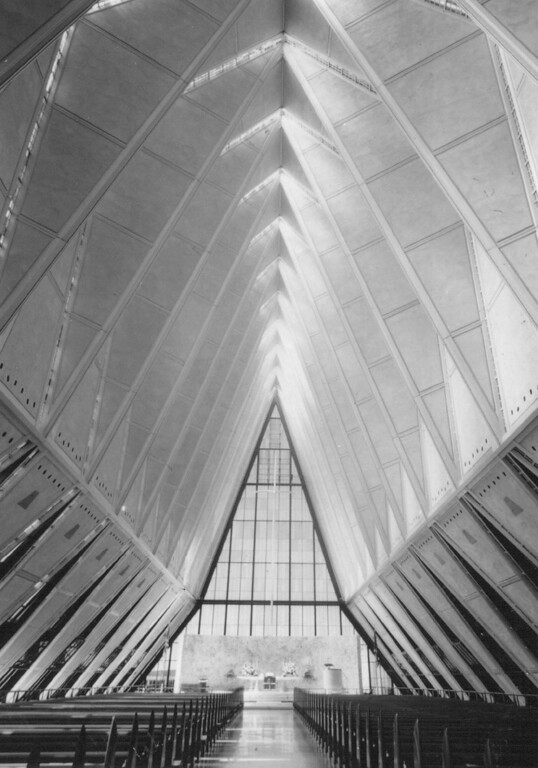 . Designed by the firm of Skidmore, Owings and Merrill, it sits at the base of the front range of the Rocky Mountains, at an elevation of nearly 7,200 feet. The soaring aluminum tetrahedrons that form the outer shell of the chapel evoke both the shape of the mountains and a person\'s hands pressed together in prayer. 1982. The Denver Post Library Archive