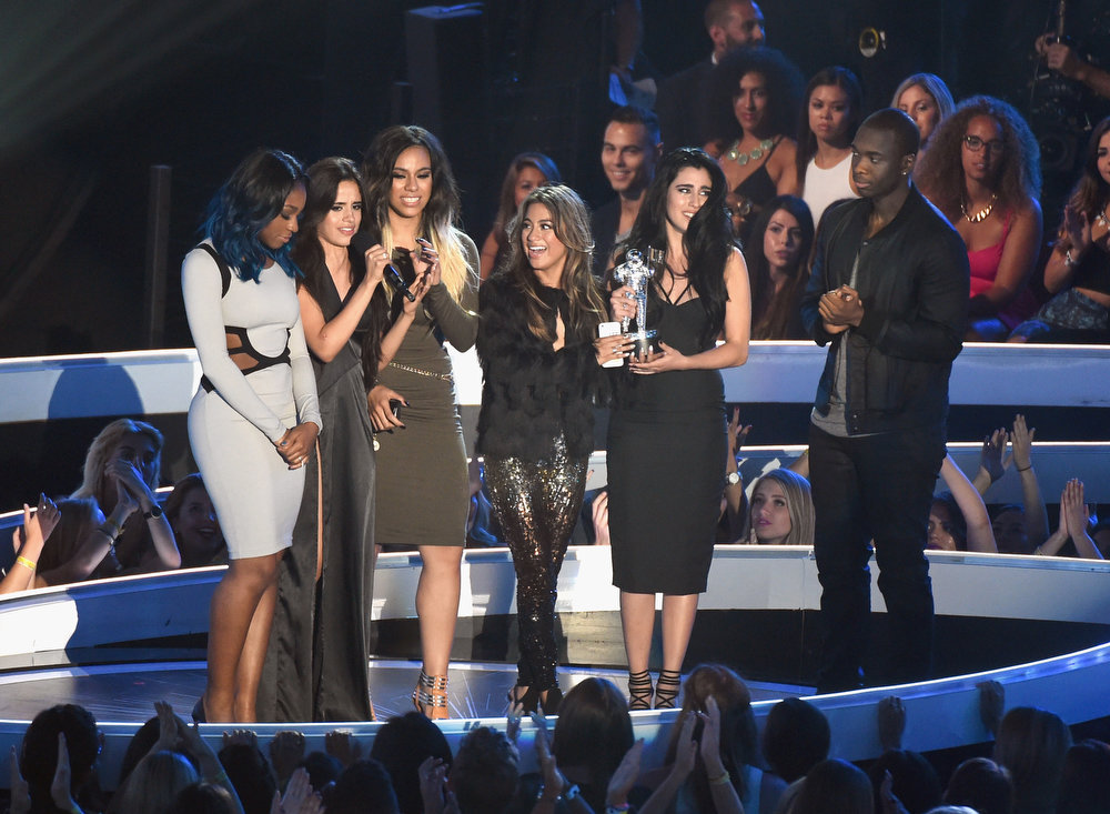 . Fifth Harmony members (L-R) Normani Hamilton, Camila Cabello, Dinah Jane Hansen, Ally Brooke and Lauren Jauregui accept the Artist to Watch award for \'Miss Movin\' On\' onstage during the 2014 MTV Video Music Awards at The Forum on August 24, 2014 in Inglewood, California.  (Photo by Michael Buckner/Getty Images)