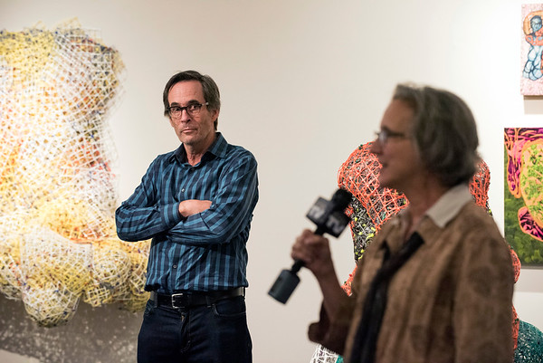 09/05/19 Wesley Bunnell | StaffrrDrip-Drop Tick-Tock, an art exhibit by CT artist Joseph Fucigna, opened on Thursday afternoon at CCSU's Maloney Hall. The pieces consist of industrial materials shaped and formed into fluid artwork. Fucigna looks on as he is introduced to the audience.